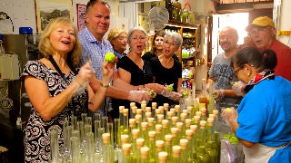 Guests learning about how Limoncello is made during our Limoncello class in Amalfi, Italy.