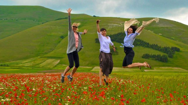 The valley of Castelluccio blooms with poppies in June, creating amazing photo opportunities for our Umbria guests