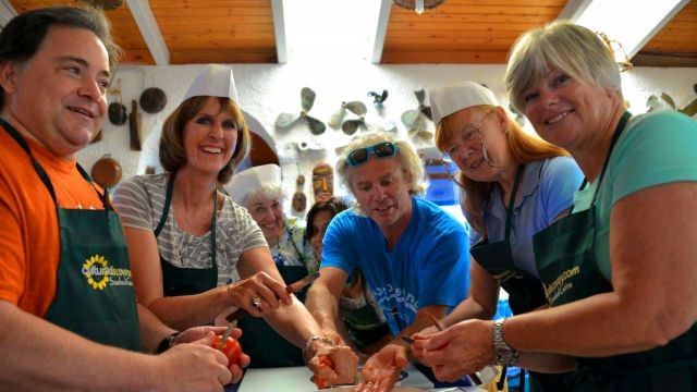 Ivan shows the group how to make proper bruschetta on our cooking and adventure on the islands of Sicily
