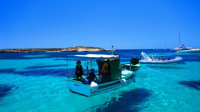 Our fishing boat appears to be floating on air, but is really in the crystal clear waters of Favignana, Sicily