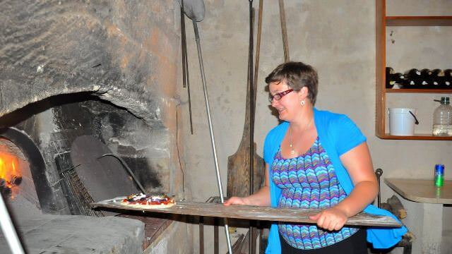 We have lots of fresh made pizza going in the wood-burning oven at the country villa with family and friends.