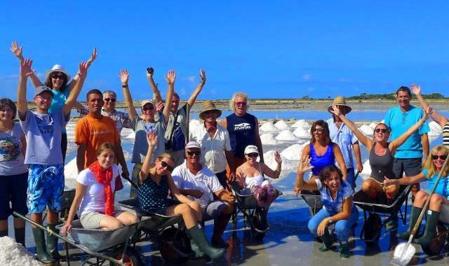 Our guests after getting their freshly-harvested salt from the saline at the Trapani, Sicily salt flats.