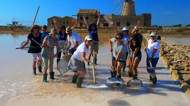 Fun beyond compare while we harvest salt at the saline in Trapani, Sicily - Truly a unique experience!